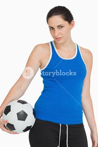 Sportswoman with a soccer ball