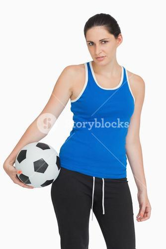 Sportswoman with a football