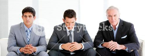 Three charismatic businessmen in a waiting room