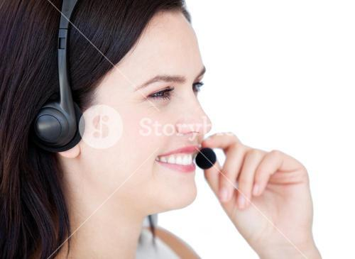 Delighted businesswoman with a headset on