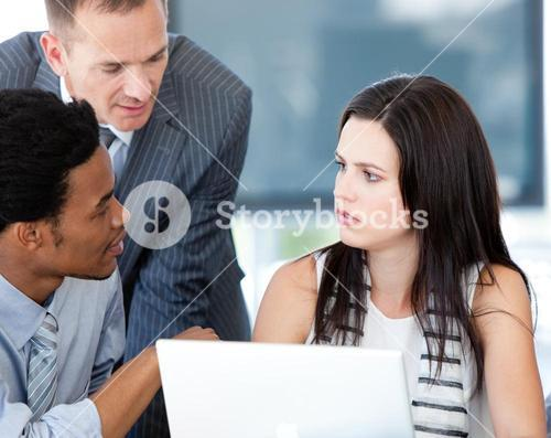 Thinking Business team working together with the laptop