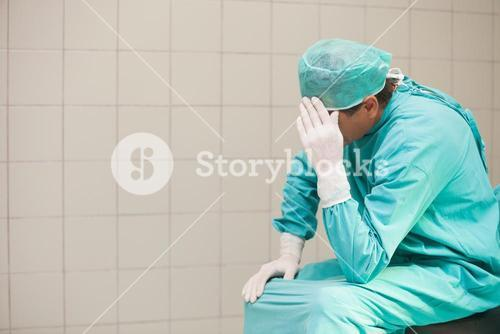 Thoughtful surgeon in a hospital
