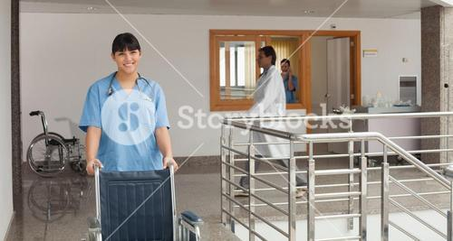 Doctors assistant pushing a wheelchair