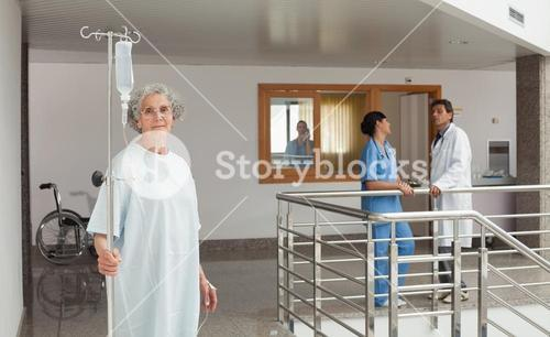 Old woman holding a drip