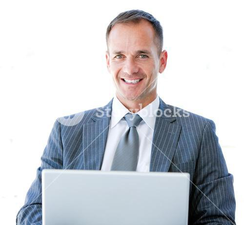 Smiling businessman surfing on the internet