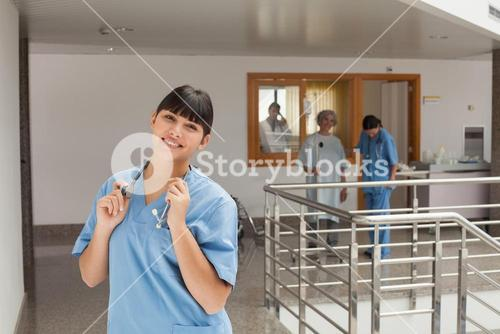 Laughing doctor standing in the hallway