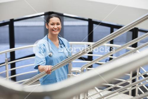 Smiling nurse in a stairwell