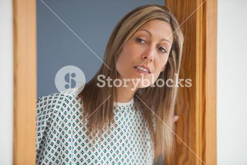 Female patient looking through doorway