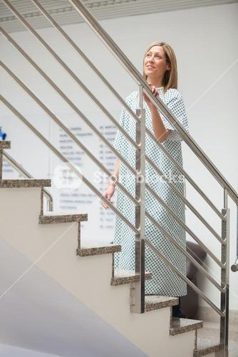 Female patient walking up stairs
