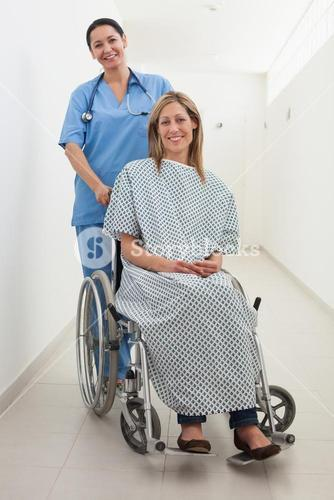 Happy nurse and patient in wheelchair