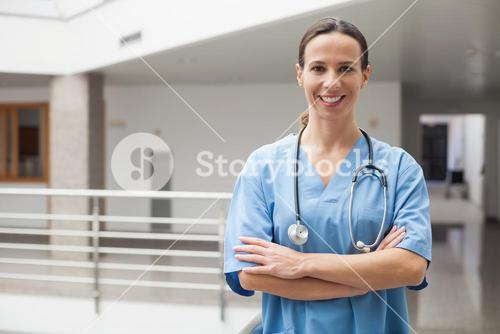 Smiling nurse with crossed arms