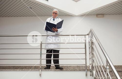 Doctor reading patient files