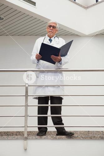 Doctor standing on the railing watching
