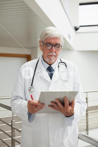 Doctor looking at patient files