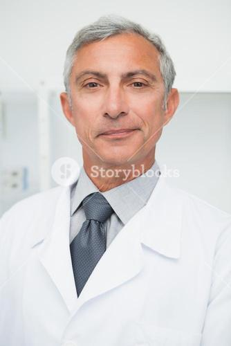 Smiling doctor wearing lab coat