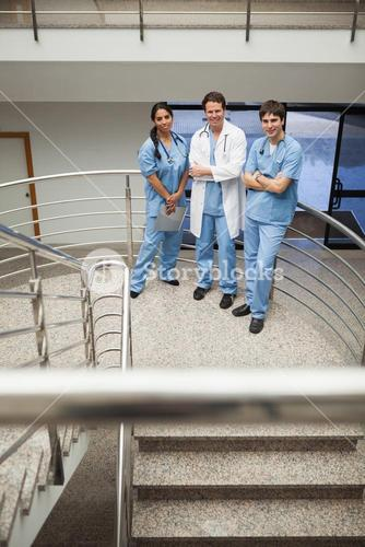 Doctor and two nurse standing on the stairs