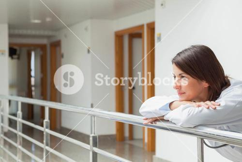 Woman leaning on the railing
