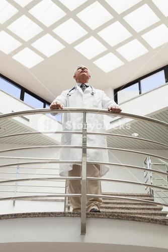 Doctor standing at the railing looking up