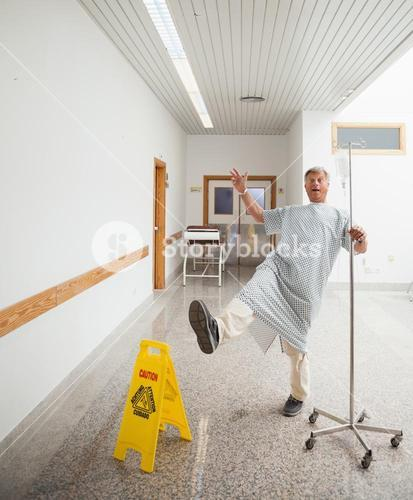 Patient pretending to slip on wet floor