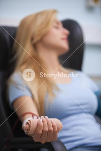 Woman relaxing while donating blood
