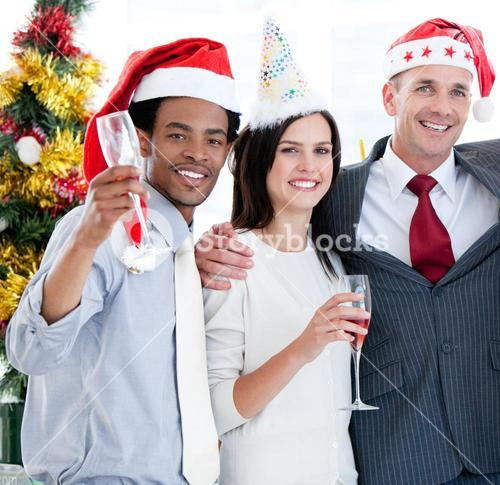 United business team drinking champagne to celebrate christmas