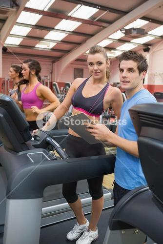 Instructor and woman in the gym