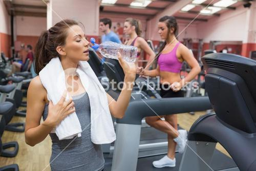 Woman thirsty in gym