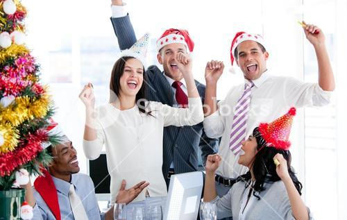 Business team punching the air to celebrate christmas