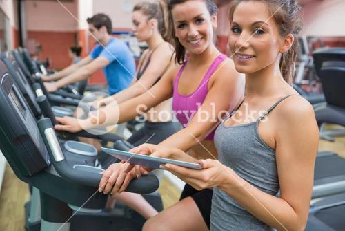 Instructor and woman smiling in the gym
