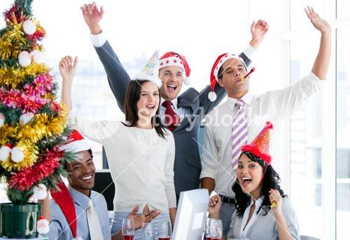 Nice business team punching the air to celebrate christmas