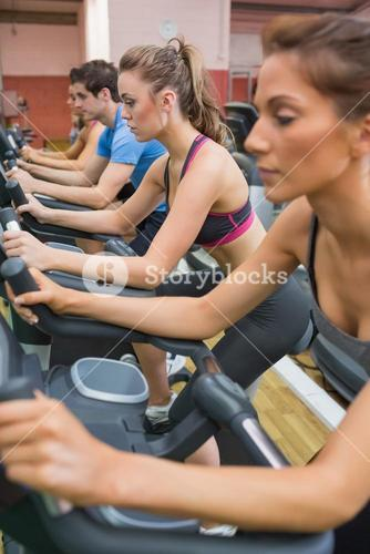 Four people on exercise bikes