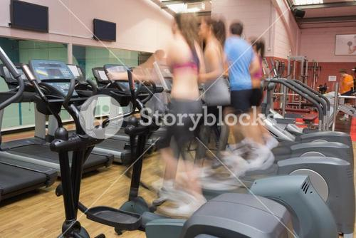 People working out on step machines at speed