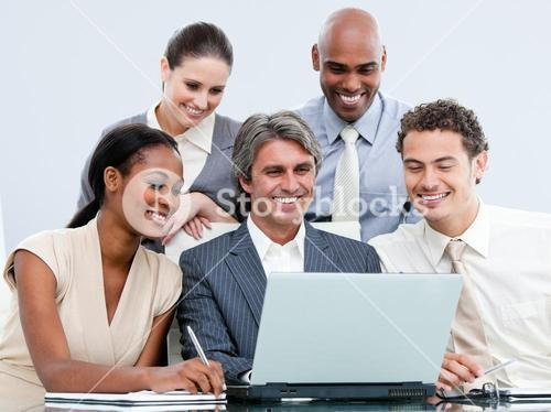 Happy Business team looking at the laptop