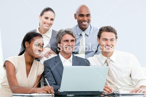 Smiling internationnal Business team working with at the laptop