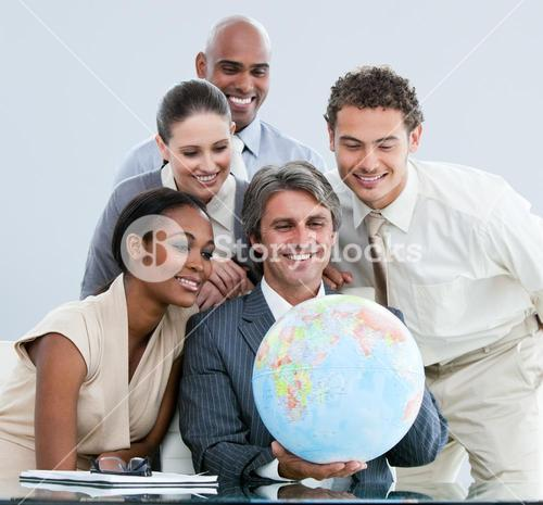 United Business team holding a globe globalization concept