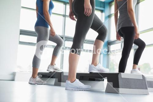 Three women in aerobics class