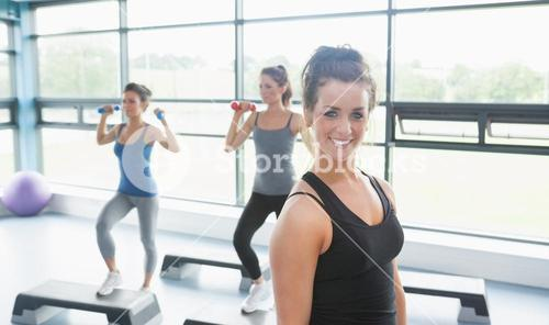 Happy woman at aerobics class