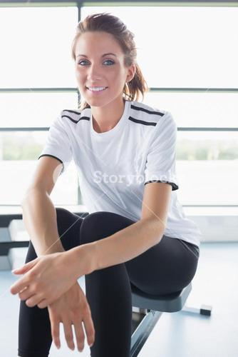 Smiling woman sitting on row machine