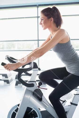 Woman riding an exercise bike