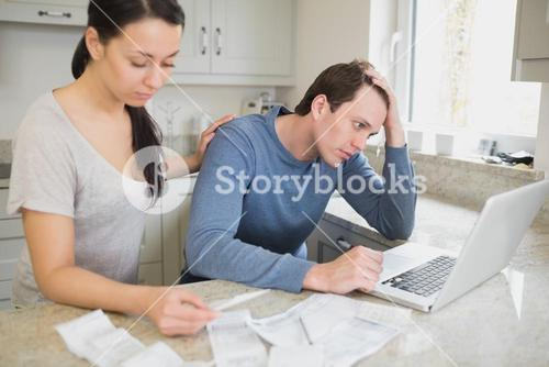 Young couple calculating finances