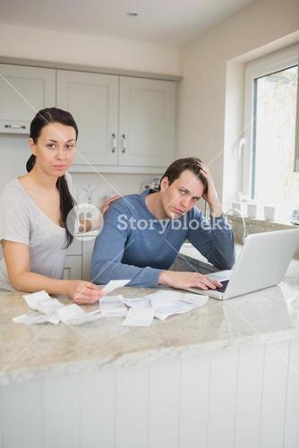 Couple calculating with the laptop