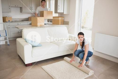 Young people furnishing their house