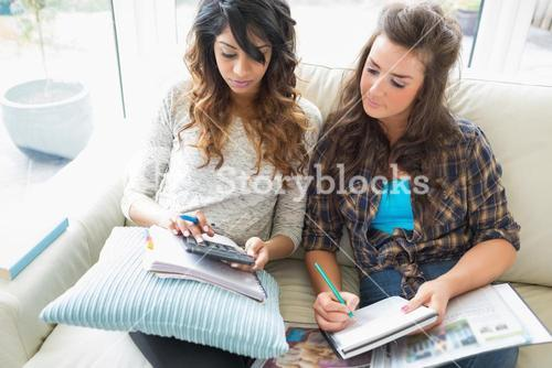 Friends helping each other with homework