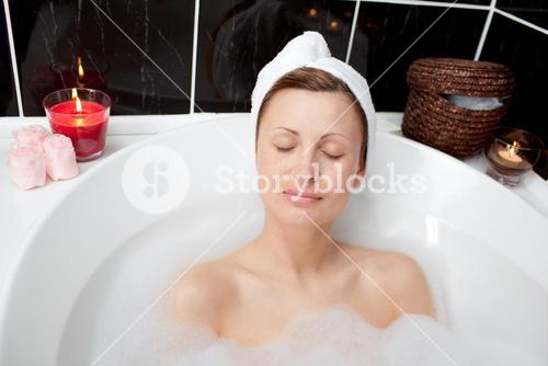 Beautiful woman relaxing in a bubble bath