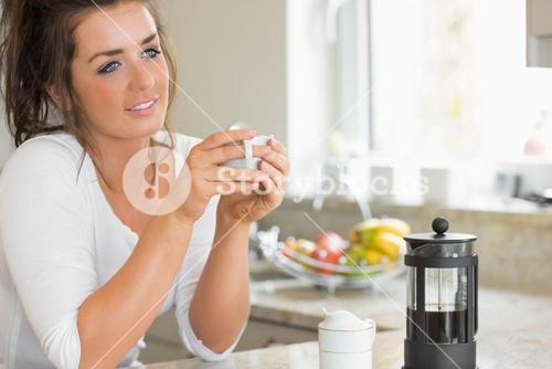 Woman thinking over coffee at breakfast