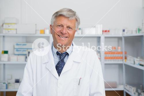 Smiling doctor in a pharmacy