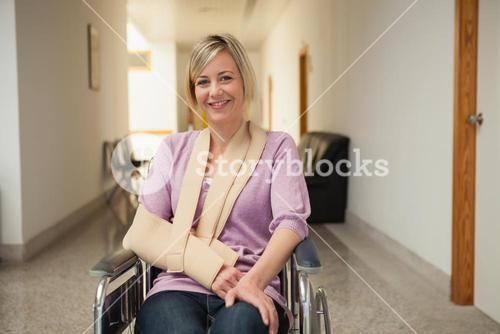 Patient in wheelchair with arm in sling