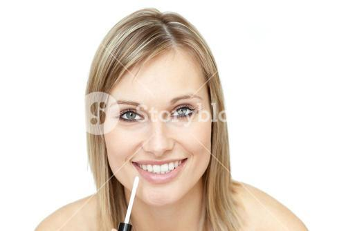 Cute woman putting gloss