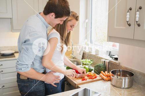 Man talking with woman while cooking