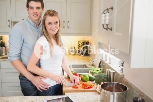 Man and woman working together in the kitchen